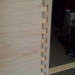 Half blind dovetails. The additional tails where trimmed for the rabbet on the side of the drawer.