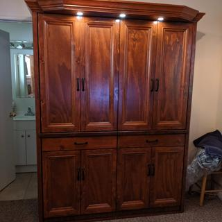 """To make it appear as a breakfront I framed cabinet """"doors"""" with moldings, drawer fronts and handles"""
