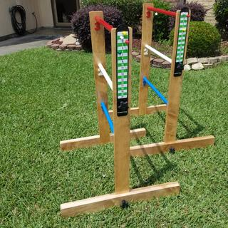 Ladder Golf set, which disassembled and fits in the box with a  carrying handle.