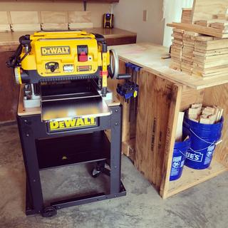 Planer and stand setup in my workshop.