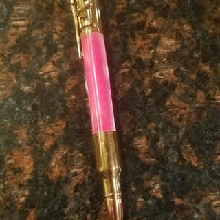 Pink acrylester as a gold bolt action pencil.