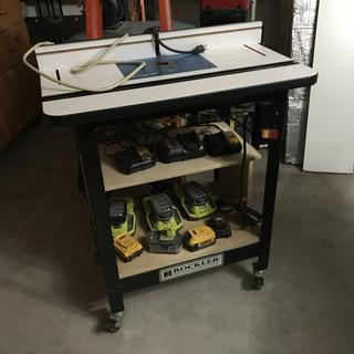 Router table and custom made charging station below