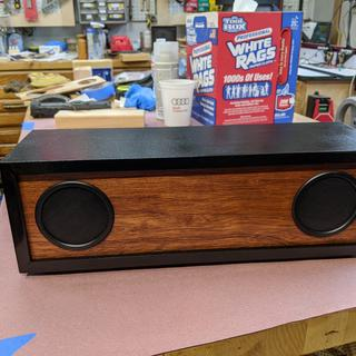 Made out of MDF and luan plywood.  Used scroll saw for the holes; that worked fine.  Sounds great!