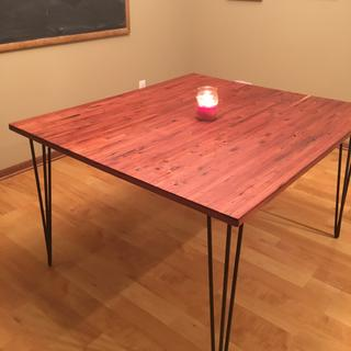Red wood table on 3 pin table legs (black)