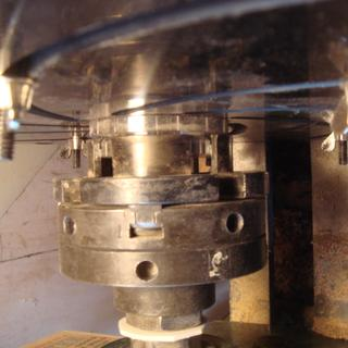 Top view of how dovetail #2 jaws of standard 4-jaw chuck BARELY grip the steel mounting plate.