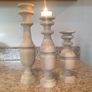 "Poplar. 12"", 10"", and 8"" candlesticks."