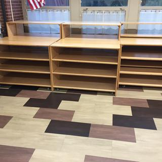 Shelves with casters easily move so that floors can be buffed and cleaned.