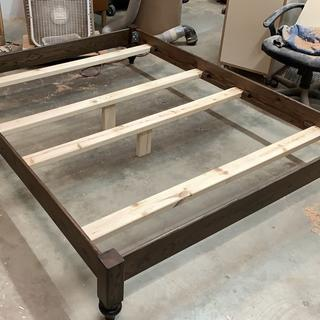 Finished bed frame, yes I stained the paint grade. Just use a light touch and rub it out.