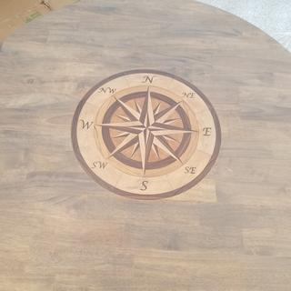 My very first router project: Wood Inlay to improve a new table. Everything worked out pretty well.