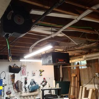 Reel mounted from ceiling rafter