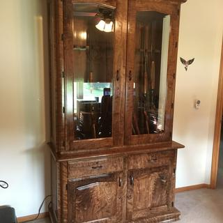 This Cabinet is a 12 Gun cabinet, & is made out of curly Walnut.