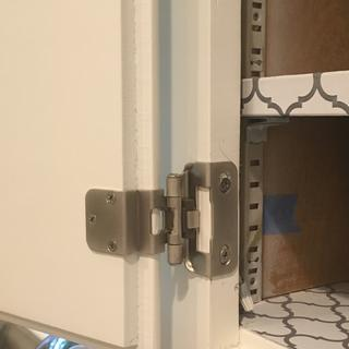 hinge attached inside cabinet