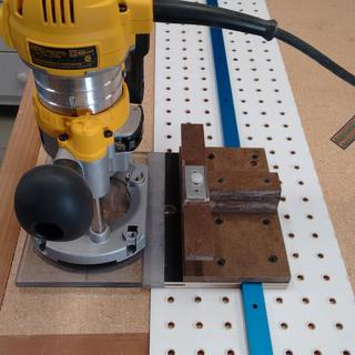 Router mounted to shelf pin jig.