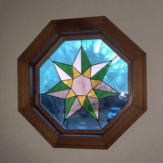 Oak frame uses V-nails and fits inside existing octagonal window.