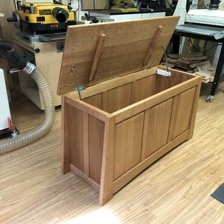 Cherry blanket chest with fragrant red cedar bottom.
