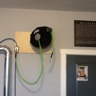 Air hose reel mounted.