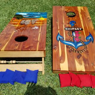 A Corn hole game set that connects together and has carrying handles for transporting.