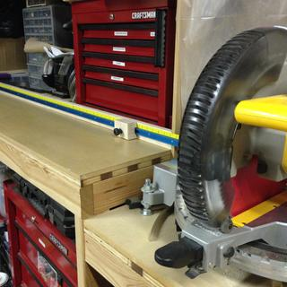Yellow tape installed just above Rockler blue T track with stop block.