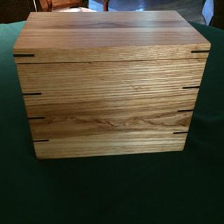 Walnut splines on a small urn box.