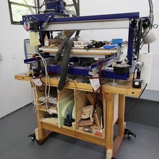 CNC machine on table using Rockler Workbench Casters.