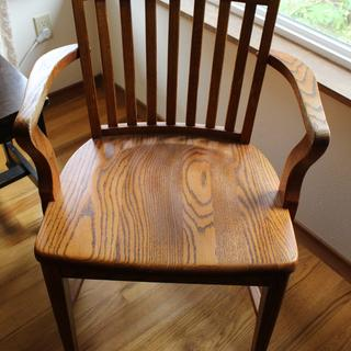 chair from a restaurant, stripped of two coats of blackish finish and refinished to show grain.