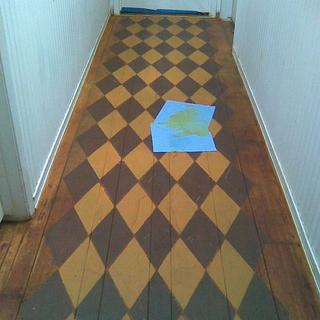 "This was the ""before the stain""  floor design with a diamond stencil pattern and my choice of paint."