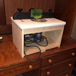 Built a small box to mount the table and my router.  Works great for small projects.