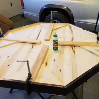 """½"""" plywood used for the table. For more stability, I glued back on the triangles that I had cut off."""