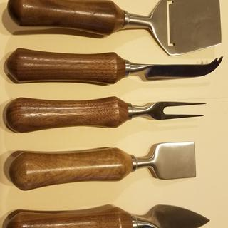 A set with Walnut Handles.
