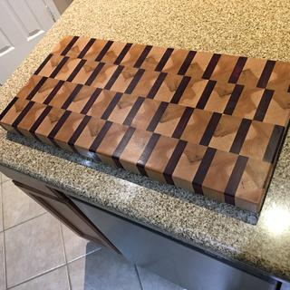 Purple heart and rock maple eng grain cutting board