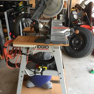 View of the entire rig.  Miter saw.  Shop vac.  I-socket switch.   Works great.