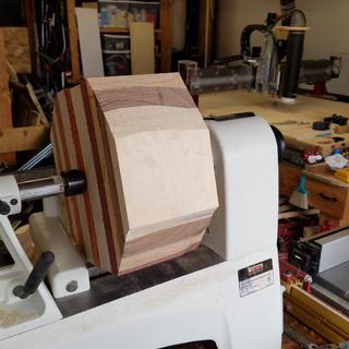 A glue up of maple, walnut, oak, purpleheart, Baltic birch, and paduk.