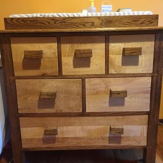 Curly Maple used for drawer fronts on dresser.