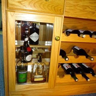 Added liquor storage on left with mirror behind it.