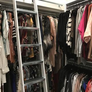 Ladder system for a custom walk-in closet.