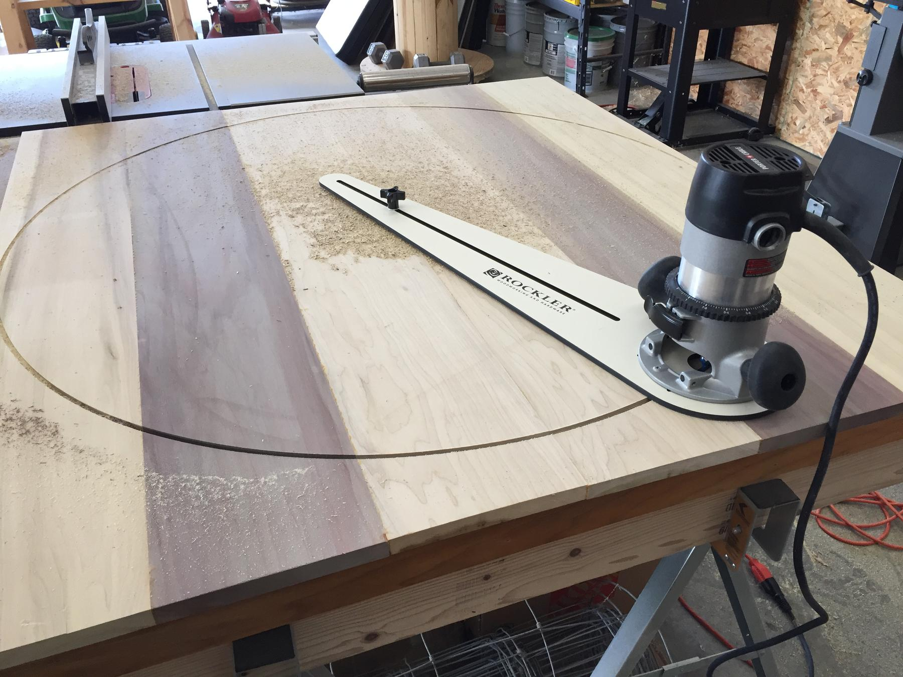 Router circle jig cutting a table top