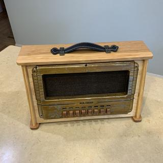 Made from scraps of pine, birch and cherry, the cabinet is representative of an old portable radio.