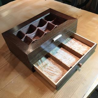 The curly maple drawer, with three compartments.