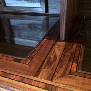 Morado inlay on surface of cabinet - the glass inserts are removable to enable changing display