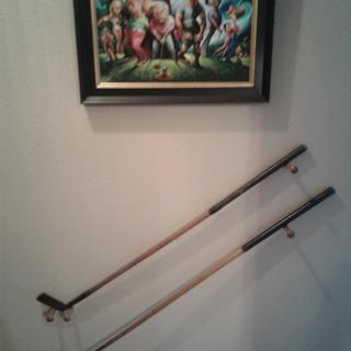 Home display of old wooden shafted golf clubs. Pegs held them up great.