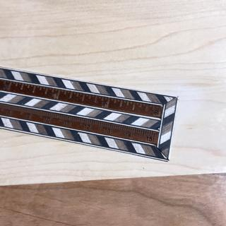 Inlay border on a wooden ruler.