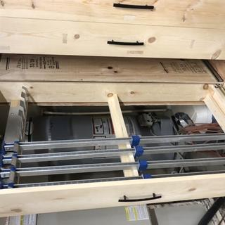 Cabinet drawer with clamp rack