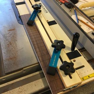 Cutting a fretboard.