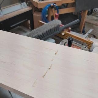 Damage on the face towards one end of the maple board