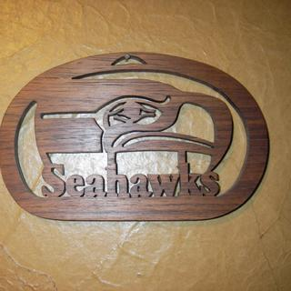 "Detailed walnut wall hanging. Size, 3"" X 4 1/4"". Lettering size between 3/8"" and 1/2""."