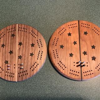 One cherry, one walnut cribbage boards.