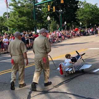 The Pedal Mustang and ground crew in action in the 4th of July Parade