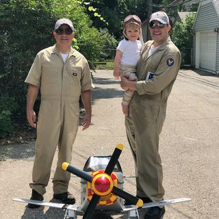 Pilot grandson with his Pedal Mustang and ground crew