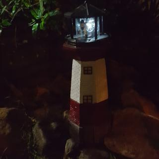 Solar lighthouse in my garden at night