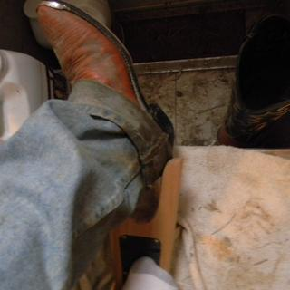 I easily take off my left Boot & pants at the same time; using my clean sock to hold the Boot Jack.